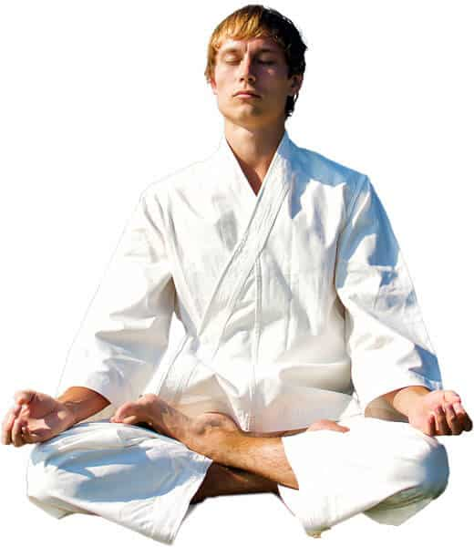 Martial Arts Lessons for Adults in Hillsborough NJ - Young Man Thinking and Meditating in White