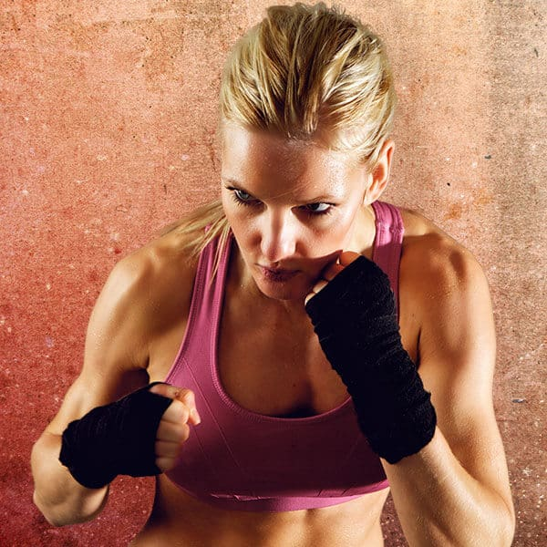 Mixed Martial Arts Lessons for Adults in Hillsborough NJ - Lady Kickboxing Focused Background