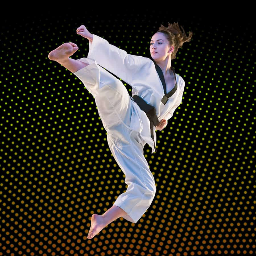 Martial Arts Lessons for Adults in Hillsborough NJ - Girl Black Belt Jumping High Kick