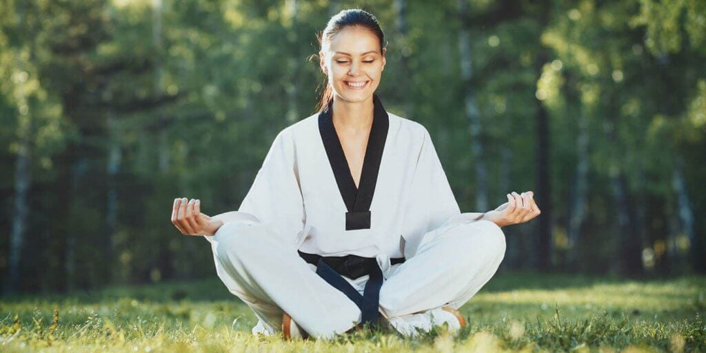 Martial Arts Lessons for Adults in Hillsborough NJ - Happy Woman Meditated Sitting Background